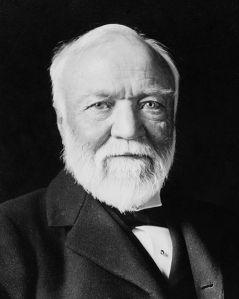 479px-Andrew_Carnegie,_three-quarter_length_portrait,_seated,_facing_slightly_left,_1913-crop